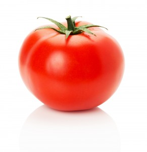 ripe tomato isolated on the white background.